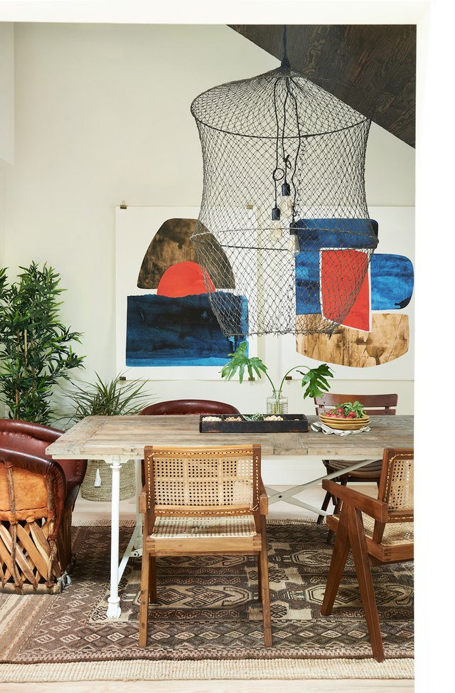 eclectic dining room with mismatched chairs