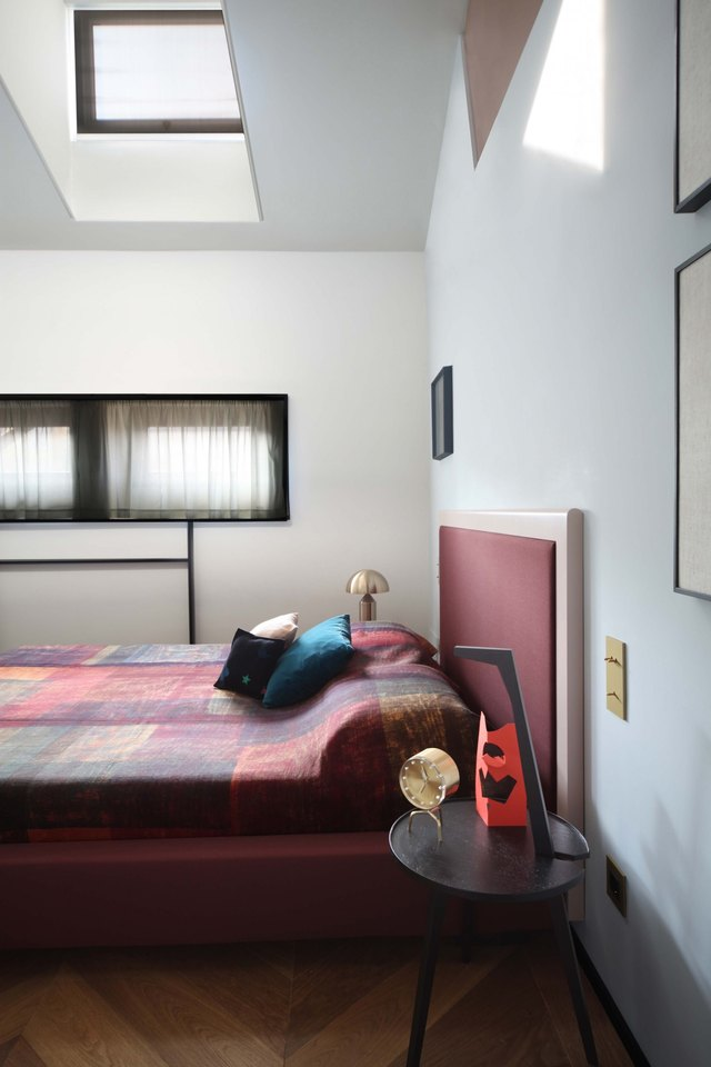 bedroom with angled roof and skylight