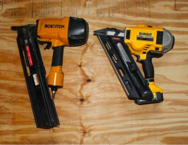 A pair of power nailers.