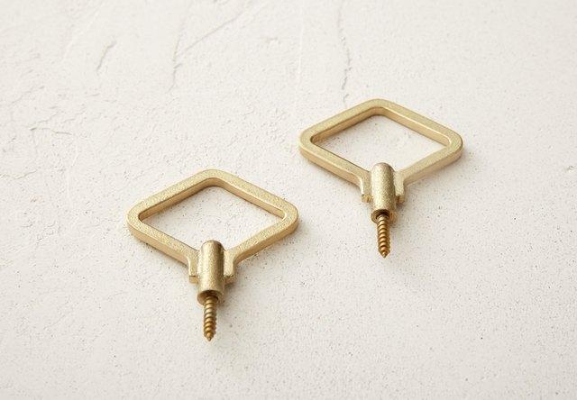 geometric wall hooks with brass finish