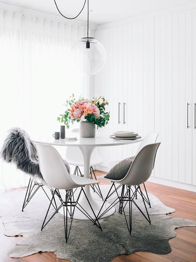 white modern glam dining room cowhide rug