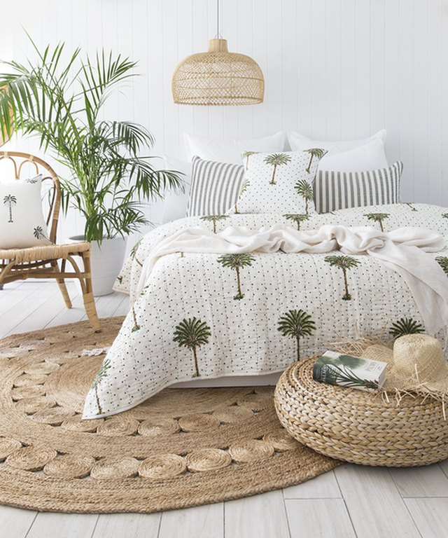 tropical bedroom with round area rug and wicker pendant light