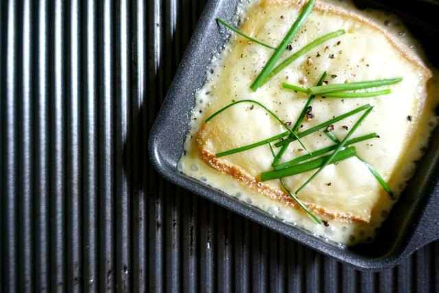 Melted raclette Cheese