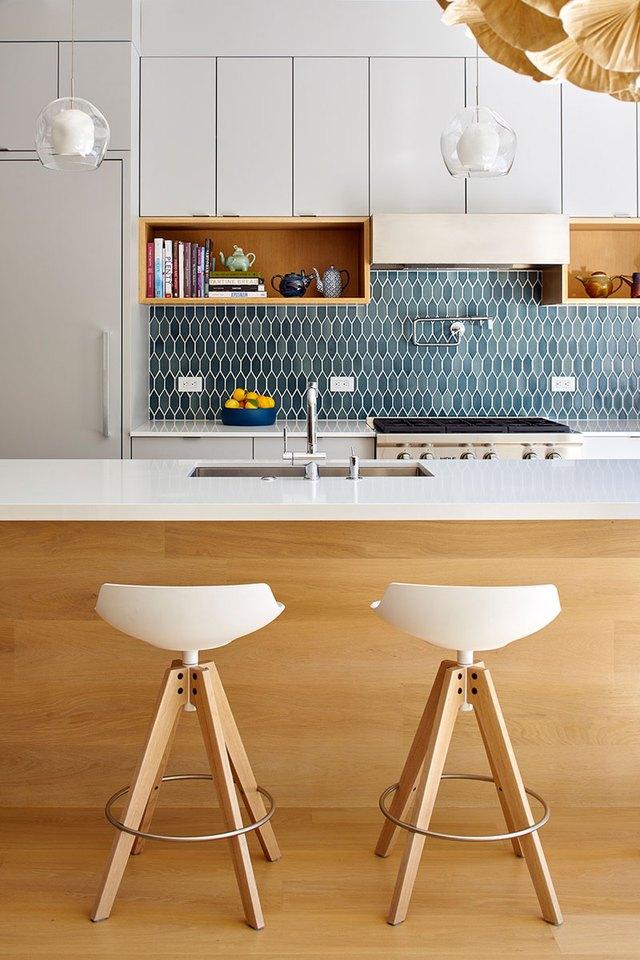 modern kitchen with teal tile backsplash