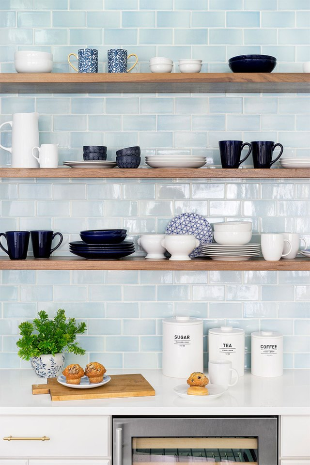 blue subway tile in modern kitchen with open shelving
