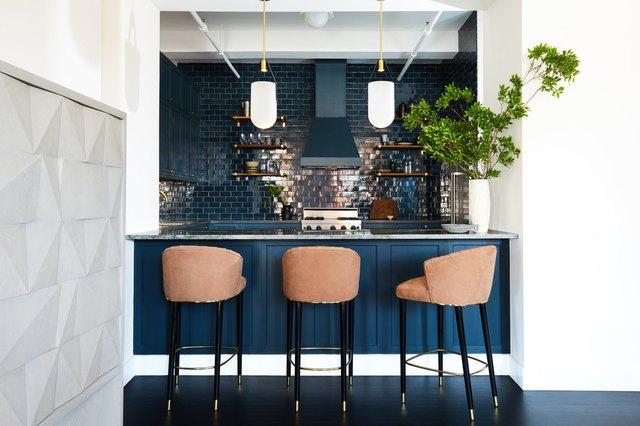 kitchen with blue cabinets and blue tile backsplash