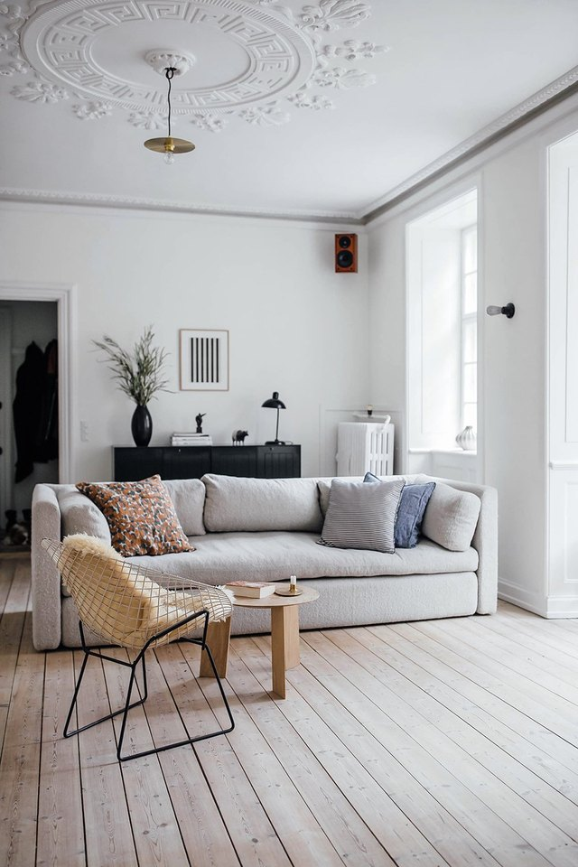 16 housewarming gifts that youll really want to keep for yourself scandinavian living room with sofa and lounge chair solutioingenieria Images