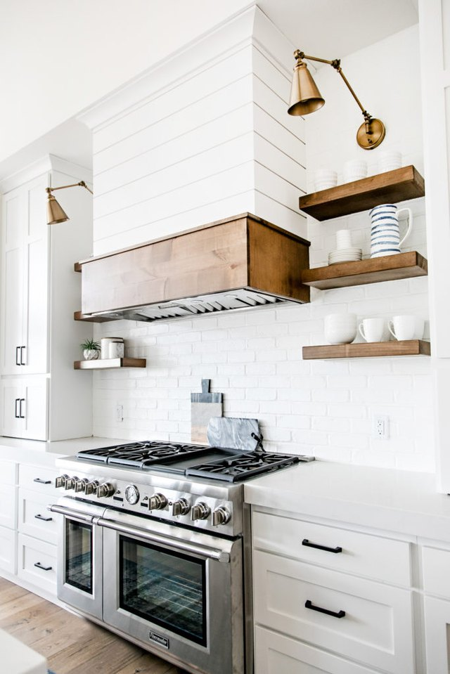 white farmhouse kitchen with shiplap walls and white subway tile backsplash