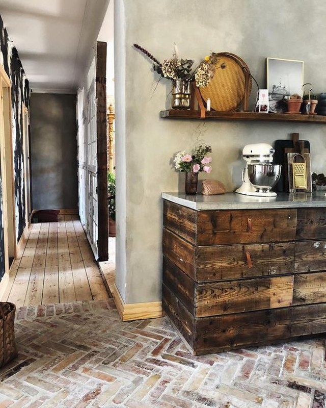 rustic kitchen with dark wood cabinets and open shelving