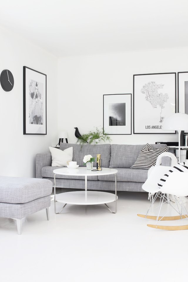 white living room with gray sofa and black accents