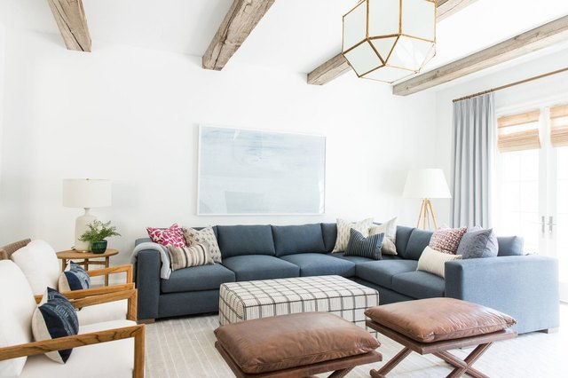 white living room with rustic wooden beams across the ceiling