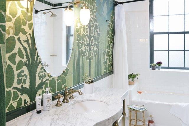 green wallpaper in bathroom