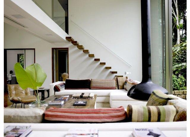 hanging fireplace in modern bohemian living room