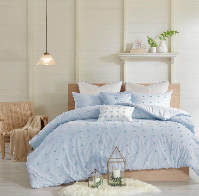light blue sheets with pom pom details