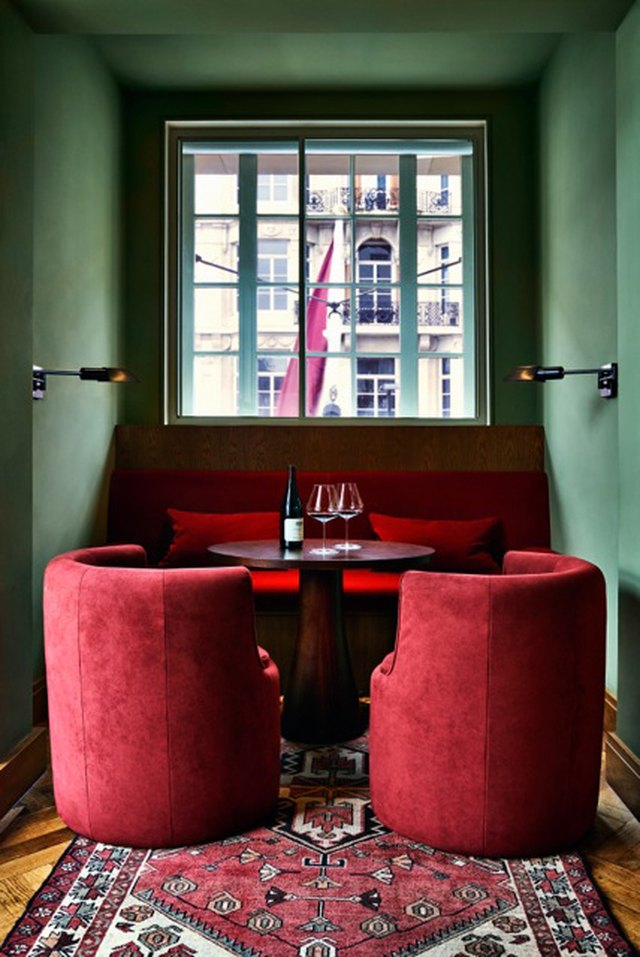 dining nook with green walls and red furniture
