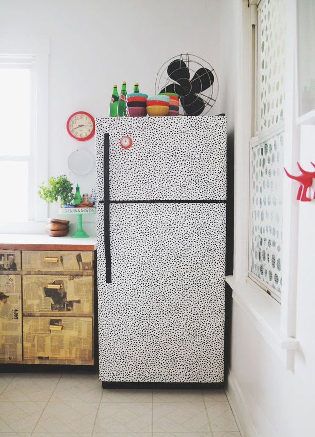 refrigerator covered in removable wallpaper