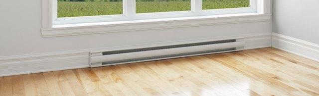 Baseboard heater under a window.