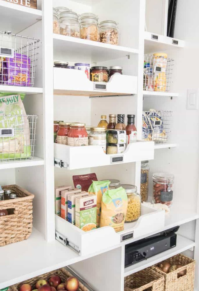 sliding drawers in organized small pantry closet