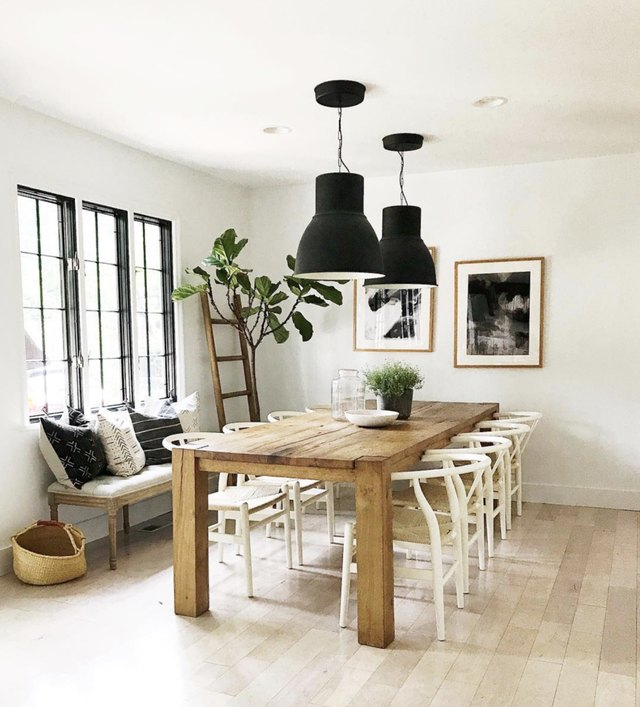 House Seven Design dining room with black industrial pendants and rustic table