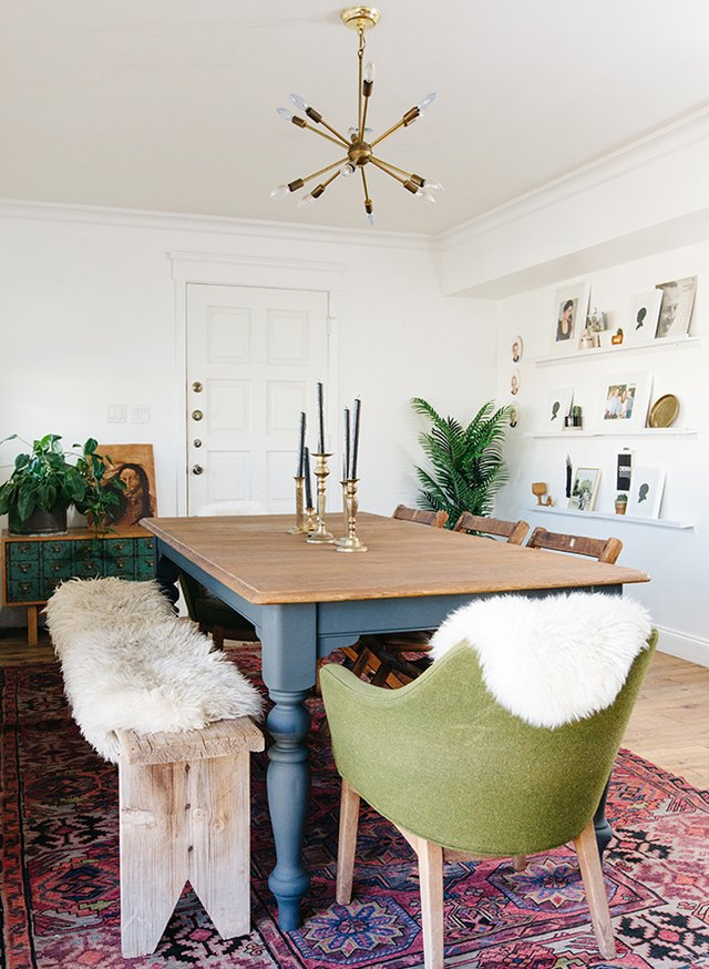 contemporary dining room with antique buffet and rustic bench