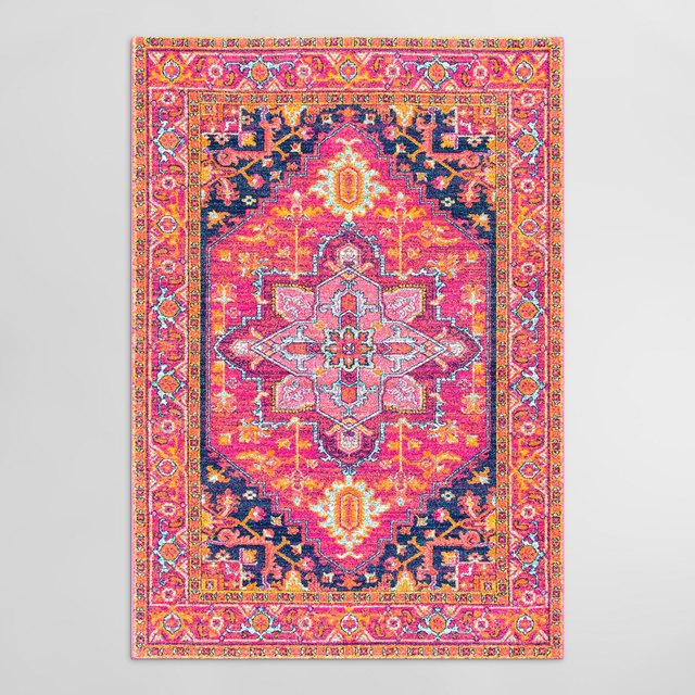 Hot pink kilim rug with orange and navy accents