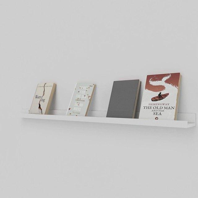 Long white ledge shelf displaying four books