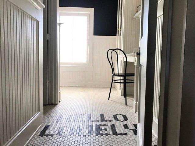 home corridor with word tile flooring