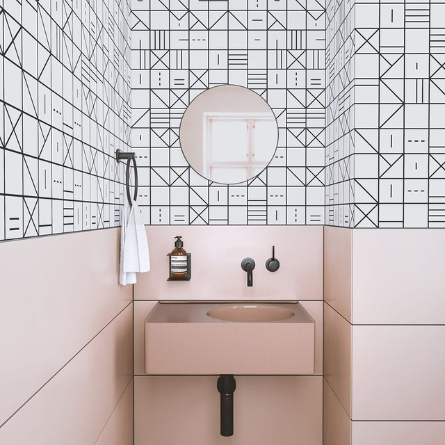 A bathroom with pink and black design details