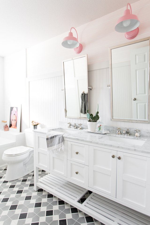 A bathroom with pink lighting