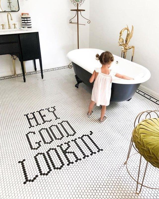 bathroom with black clawfoot bathtub and black vanity cabinet