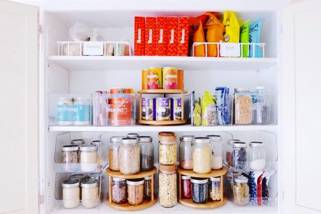 organized small pantry closet with lazy Susans