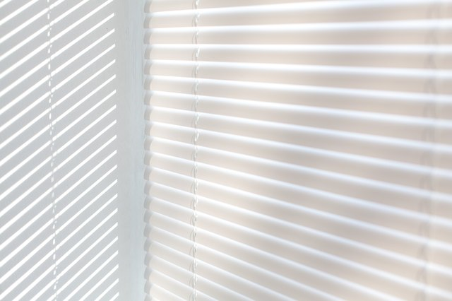 Venetian blinds background with sun light