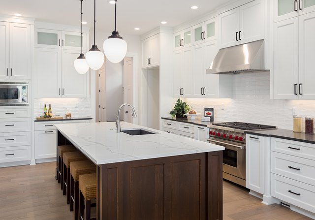 Beautiful Kitchen In New Luxury Home With Large Island, Pendant Lights,  Oven, Range
