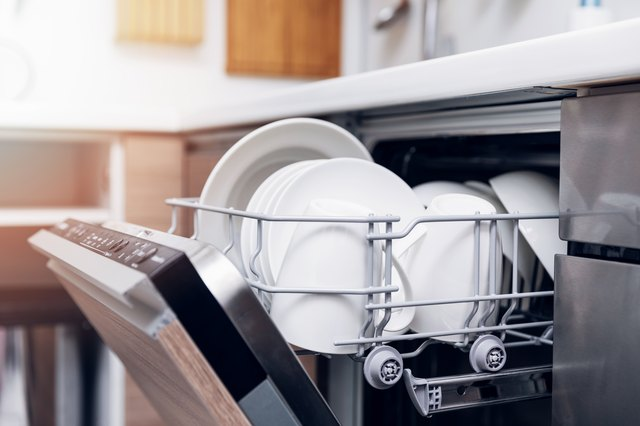 Open Dishwasher With Clean Dishes At Home Kitchen