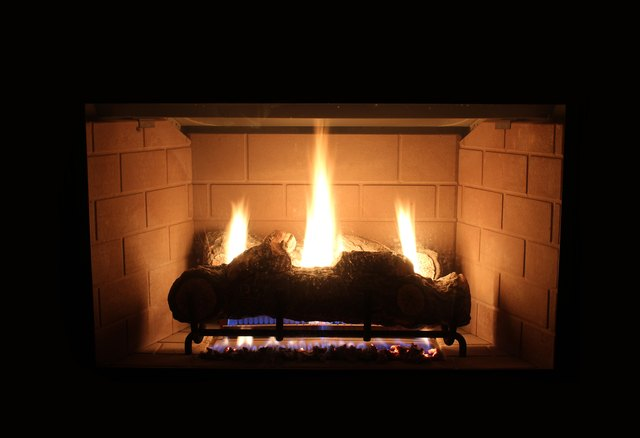 A log burning fire and fireplace