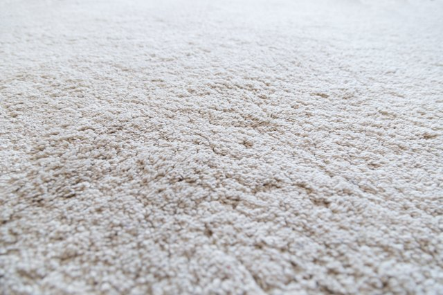 Close-up of a white shaggy carpet, shallow depth of field