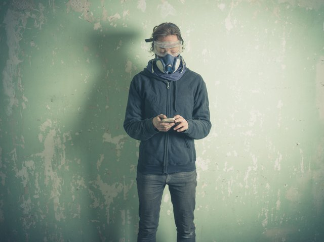 Young woman in protective gear using smart phone