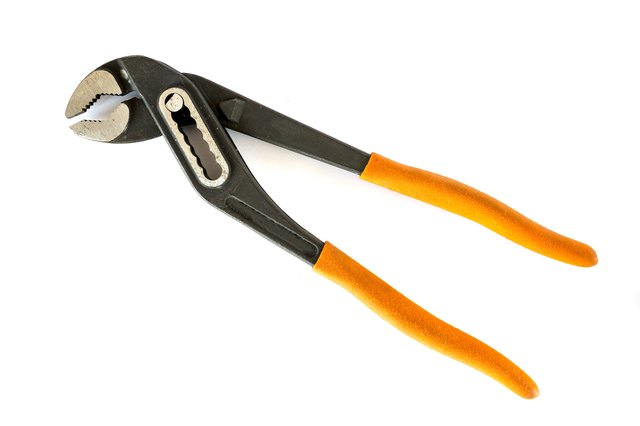 Adjustable pliers on white background