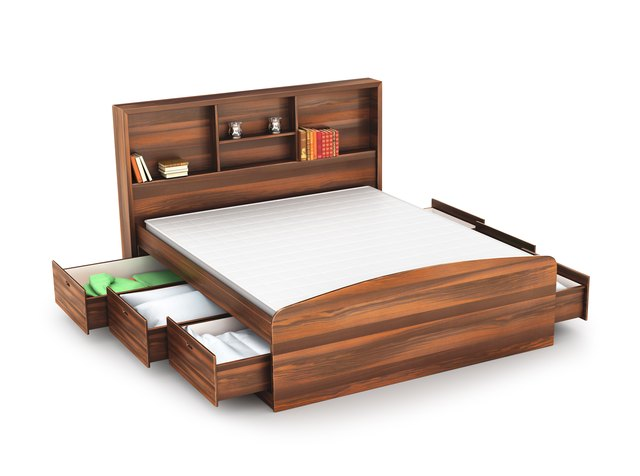 wooden bed with open drawer