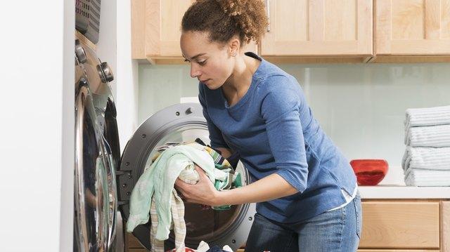 Black woman doing laundry