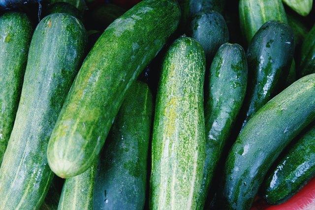 Full Frame Shot Of Wet Zucchinis At Market