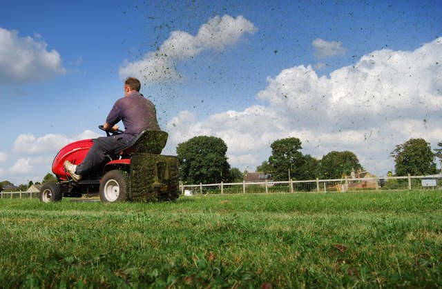 Man mowing the grass on a riding mower