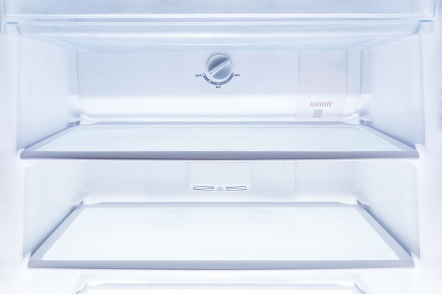 inside of clean and empty refrigerator with shelves, good background for health or diet concept