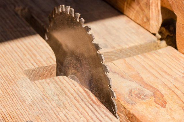 A homeowners guide to saw blades hunker circular saw blade for cutting wood closeup at selective focus greentooth Image collections