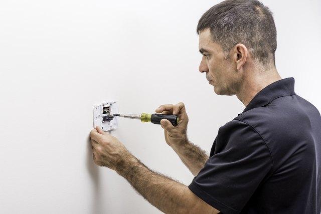 Hvac Tech Installing Thermostat