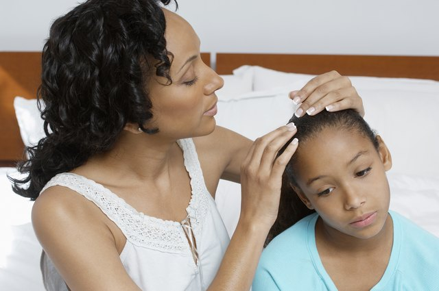 Mother examining daughter (7-9) in hospital