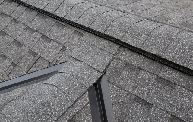 Shingled roof with peaks and valleys on the dormer