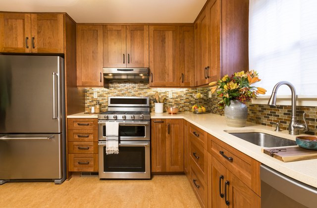 contemporary upscale kitchen with wood cabinets and stainless steel appliances - Alder Kitchen Cabinets