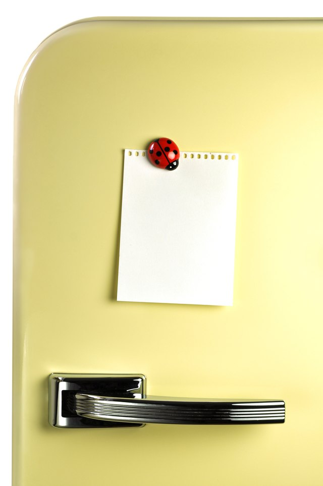 Paper on fridge with magnet