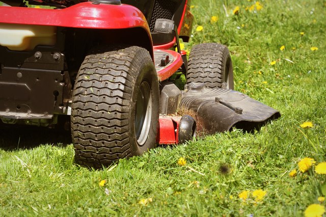 cutting the grass of on a tractor lawn mower